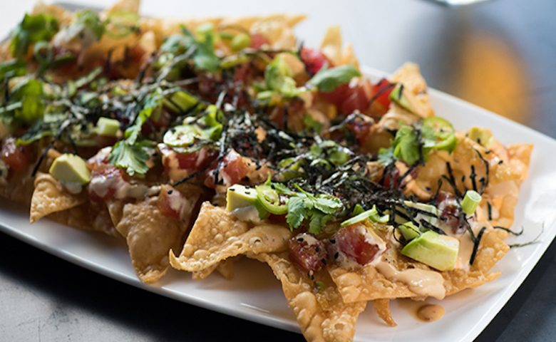 Nachos with tuna and salmon on top