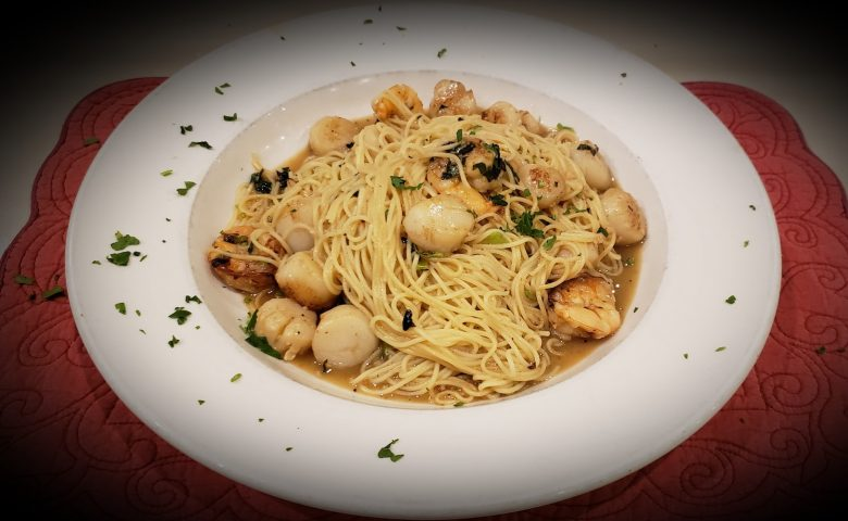 plate with pasta and scallops