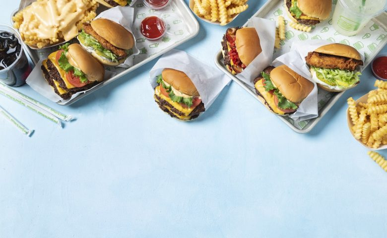 burgers and fries on a blue background
